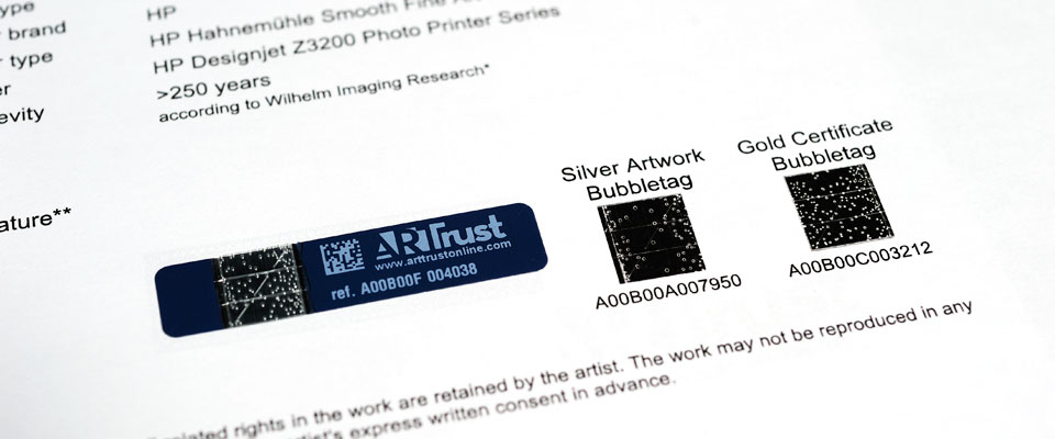 The images of the linked ArtTrust tag set are printed on the certificates so that even if the online database of ArtTrust is not running, the artwork will still be able to be authenticated by physical comparisons using the certificates.