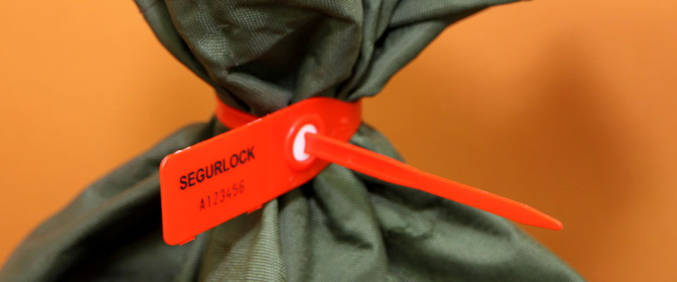 A versatile seal, the SegurLock is able to be used on many applications, including mail bags.