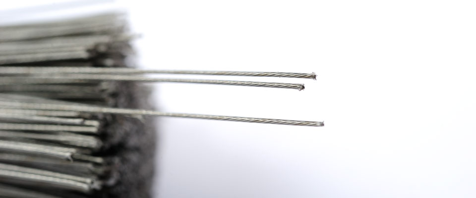 Nylon coated metal wire is gentle to fingers but has great breaking strength.